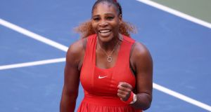 Serena Williams celebrates her victory over Sloane Stephen in the third round of the US Open. Photograph: Al Bello/Getty
