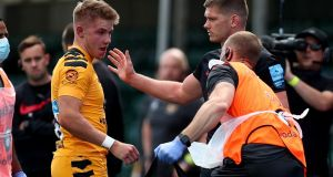 Saracens' Owen Farrell  apologises to Charlie Atkinson of Wasps after being sent off for a high tackle on him during the Gallagher Premiership  match at the Allianz Stadium on Saturday. Photograph: Clive Rose/Getty Images