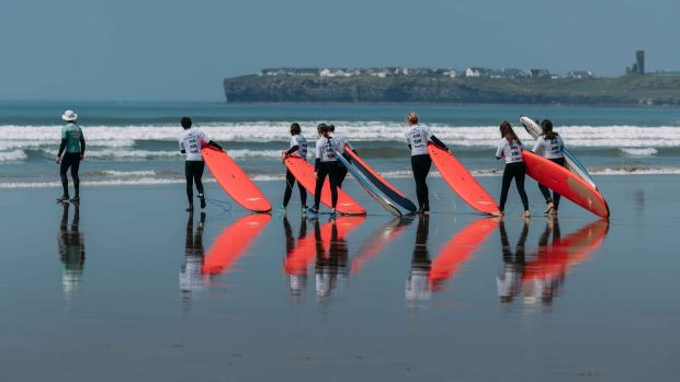 Surfing lessons: taking to the waves at Lahinch, Co Clare. Photograph: Eamon Ward