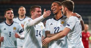 Ryan Christie (right) is congratulated by his Scotland team-mates after scoring from the penalty spot during the Uefa Nations Cup game against the Czech republic  in Olomouc. Photograph: Martin Divisek/EPA