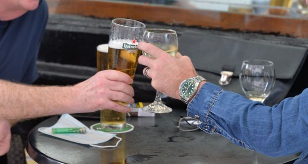 Customers enjoy a pint and a glass of wine after a meal at The Duke pub on Dublin's Duke Street on Tuesday. Photograph: Alan Betson / The Irish Times