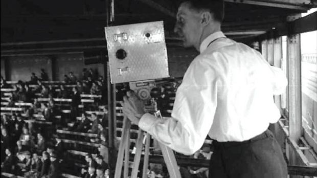 A camera operator at the 1957 All-Ireland hurling final. Photograph: IFI