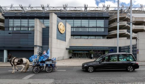 SPORTING LIFE: The funeral cortege of Dublin superfan Tony Broughan passes Croke Park on the way to the cemetery. Photograph: Colin Keegan/Collins