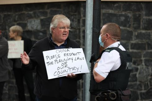 CONSULATE PROTEST: A man is seen at a protest at the Chinese consulate in Belfast amid a row over the construction of a wall and gate without planning permission. Photograph: Liam McBurney/PA Wire