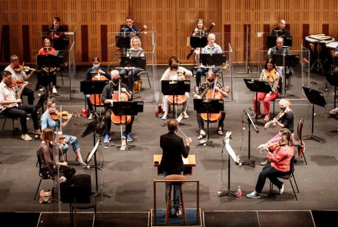 ORCHESTRAL MANOEUVRES: David Brophy conducts the RTÉ National Symphony Orchestra players at their first rehearsal at the National Concert Hall since lockdown. Photograph: Andres Poveda