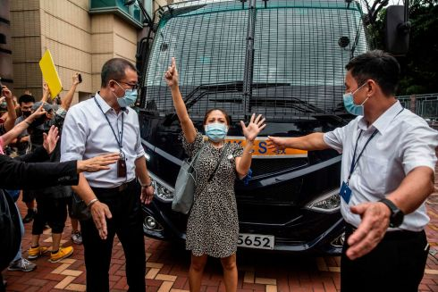 HONG KONG UNREST: A pro-democracy supporter blocks a prison van transporting activist Tam Tak-chi after he was charged with sedition in Hong Kong. Photograph: Isaac Lawrence/AFP via Getty Images
