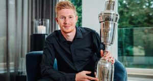 Manchester City's Kevin De Bruyne shows off his PFA men's player of the year award. Photograph:  Manchester City Football Club/PA Wire
