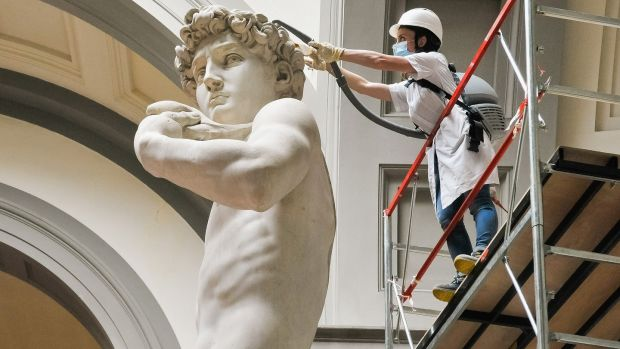 A restorer cleans Michelangelo's David statue while preparing for the reopening of the Galleria dell'Accademia which was closed for almost three months due to coronavirus. Photograph: Laura Lezza/Getty Images