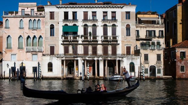 People enjoy a gondola ride in VenicePhotograph: Tiziana Fabi/AFP via Getty Images