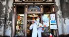 A waiter wearing a face mask serves drinks at Cafe Florian in Venice. Photograph: Alberto Pizzoli/AFP via Getty Images