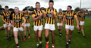 Shelmaliers' Brian  and Glen Malone (centre) celebrate  the Wexford SHC Final victory over Naomh Éanna at   Wexford Park. Photograph: Laszlo Geczo/Inpho