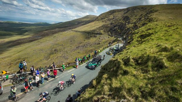 The chasing bunch climb the Conor Pass on stage 3 of the An Post Rás in 2016. Photograph: Morgan Treacy/Inpho