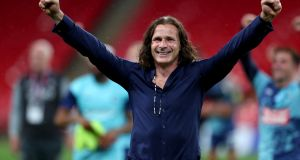 Wycombe Wanderers manager  Gareth Ainsworth  celebrates after the  League One playoff final against  Oxford United at Wembley Stadium. Photograph:  Catherine Ivill/Getty Images