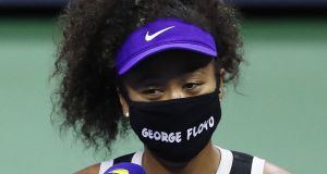 Japan's  Naomi Osaka  wearing a mask with the name of George Floyd on it during an interview following her  quarter-final  win against Shelby Rogers of the United States at the US Open. Photograph:   Matthew Stockman/Getty Images