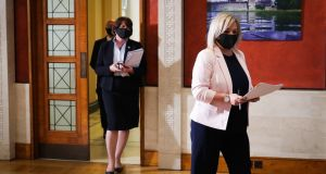 First Minister Arlene Foster (left) and Deputy First Minister Michelle O'Neill arrive for the media broadcast at Parliament Buildings, Stormont, in Belfast on Thursday. Photograph: Kelvin Boyes/Press Eye/PA Wire