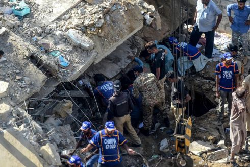 PAKISTAN: Rescue workers and residents search for the victims in the debris of a collapsed a multistorey residential building in Karachi, Pakistan. At least one man was killed. Photograph: Asif Hassan/AFP via Getty Images