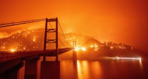 The Bidwell Bar Bridge is surrounded by fire at Lake Oroville, California this week. Photograph: Josh Edelson/AFP