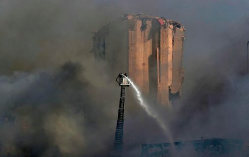 BEIRUT: Lebanese firefighters stand on a ladder amid billowing smoke as they extinguish the remaining flames at the seaport of Beirut, a day after a huge fire erupted in harbour warehouses. Photograph: Anwar Amro/AFP via Getty