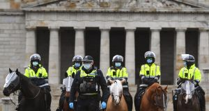 Police stand guard in front of the Shrine of Remembrance during an anti-lockdown rally in Melbourne on Saturday as the city continues to enforce strict lockdown measure to battle a second wave of Covid-19 coronavirus infections. Photograph: William West/ AFP/Getty