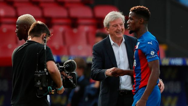 Crystal Palace manager Roy Hodgson congratulates Wilfried Zaha after his side's narrow victory over Southampton. Photograph: Alastair Grant/Getty/AFP