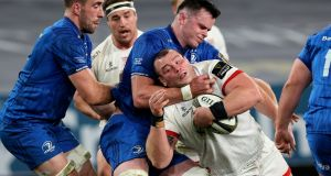 James Ryan tackles Jack McGrath during Leinster's win over Ulster. Photograph: Billy Stickland/Inpho