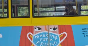 A passenger  wears a mask on a bus in Dublin city centre. Photograph: Alan Betson