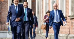 Taoiseach Micheál Martin, Tánaiste Leo Varadkar and Minister for Health Stephen Donnelly arriving at Dublin Castle to unveil the new Covid-19 plan. Photograph: Julien Behal/PA Wire