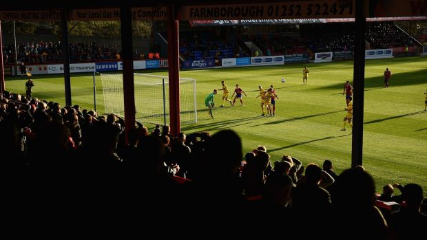 Aldershot fans watch from the stands during the FA Cup match against Torquay United in 2014. Photograph: Christopher Lee/Getty Images