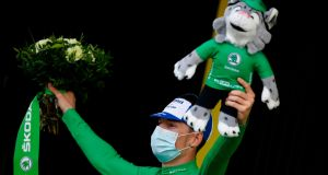 Ireland's Sam Bennett celebrates retaining his green jersey on the podium at the end of 16th stage of the Tour de France. Photograph: Getty Images