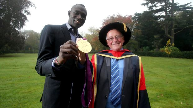 Brother Colm O'Connell and Olympic gold medallist David Rudisha pictured in 2012 when Br O'Connell received an honorary doctorate from Dublin City University in recognition of his contribution to sport through his athletics coaching programme in Kenya's Rift Valley. Photograph: Dan Sheridan/Inpho