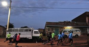 Kenyan national athletes running through Iten in the Rift Valley. Photograph:  Simon Maina/AFP via Getty Images