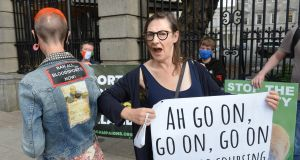 Actress Pauline McLynn, pictured with Diane Keevans , from Sligo (wearing a Father Ted Jacket) joined a protest in support of banning hare-coursing at the Dáil. Photograph: Dara Mac Dónaill