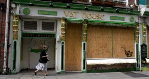 The Vat House pub in Dublin's city centre, which is boarded upduring the Covid-19 pandemic. Photograph: Gareth Chaney/Collins