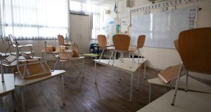 An empty primary classroom in  Israel which has closed its schools as part of a lockdown in Tel Aviv. There have been 13 outbreaks of Covid-19 in Irish schools since September which have led to some classes being as to self-isolate. Photograph: Sebastian Scheiner/AP