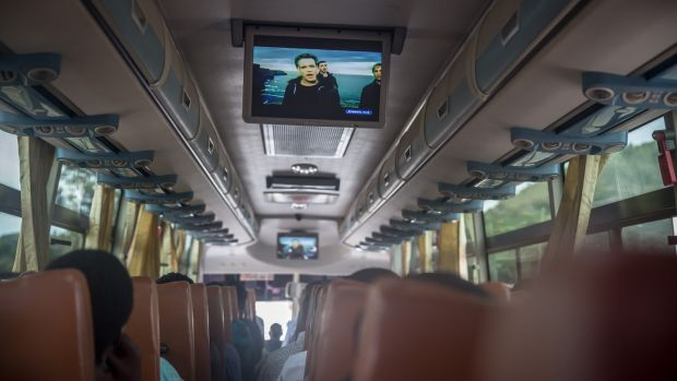 Westlife's video for 'My Love' plays on the bus between Kigali, Rwanda, and Kampala, Uganda, in March 2020. Photograph: Sally Hayden.