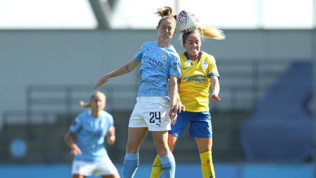 Keira Walsh of Manchester City wins a header over Denise O'Sullivan of Brighton and Hove Albion during the FA Women's Super League match at Manchester City Football Academy on September 13th. Photograph: Charlotte Tattersall/Getty Images