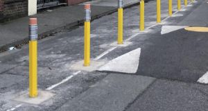 """The bollards are part of a trial to discourage motorised drop-offs and make the place safer for children."""