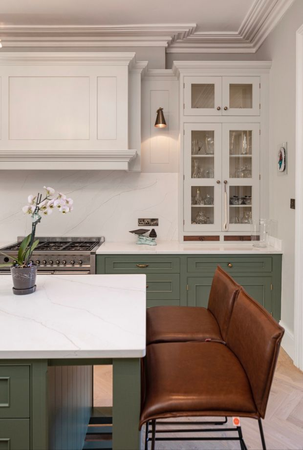 Greys, navy and greens are very popular for kitchens. Pair these with a bright countertop for a lovely contrast