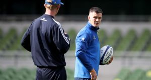 Leinster outhalf Johnny Sexton talks to head coach Leo Cullen during Friday's Captain's Run at the Aviva Stadium. Photograph: Dan Sheridan/Inpho