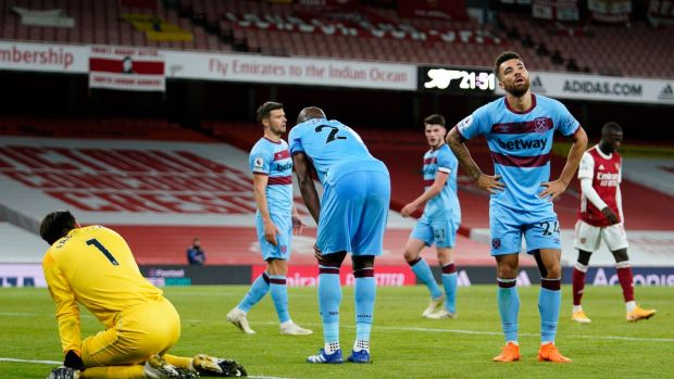 West Ham players look dejected adrer Arsenal's winner. Photograph: Will Oliver/EPA