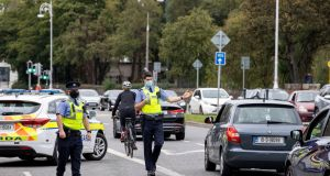 Garda checkpoints in Fairview, Dublin following the introduction of Level 3 restrictions. Photograph: Tom Honan / The Irish Times.