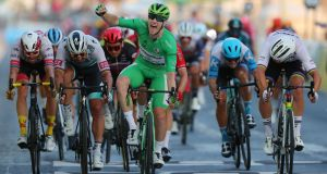 Sam Bennett in the green jersey celebrates as he crosses the finish line at the last stage of the Tour de France in Paris on Sunday.  He is the first Irish rider to win the final stage. Photograph:  Thibault Camus/AFP via Getty Images