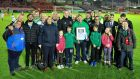 John Kennedy: pictured in green top holding framed photograph. Photograph: Cork City FC