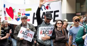 Anti-racism campaigners taking part in a rally last year outside Google  headquarters on Barrow Street in Dublin. Photograph: Tom Honan/The Irish Times