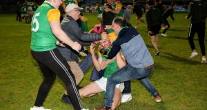 Supporters invade the pitch at Healy Park following Dungannon's win over Trillick. Photograph: Lorcan Doherty/Inpho