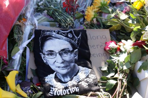 NOTORIOUS RBG: Flowers and tributes to late US Supreme Court justice Ruth Bader Ginsburg pile up at a makeshift memorial in front of the court, in Washington, DC. Ms Ginsburg died last Friday aged 87. Photograph: Alex Wong/Getty