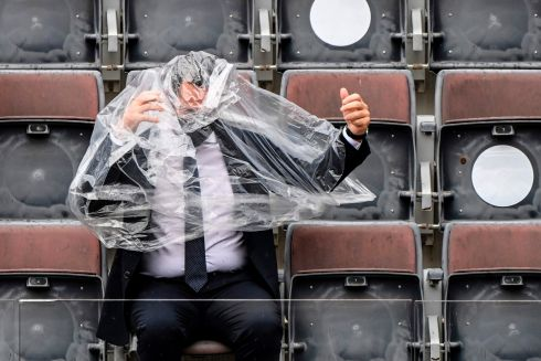 SUNNY ITALY? Italian sports minister Vincenzo Spadafora covers himself amid rain during the final tennis match of the Men's Italian Open between Serbia's Novak Djokovic and Argentina's Diego Schwartzman, at Foro Italico in Rome, Italy. Photograph: Riccardo Antimiani/AFP/Getty