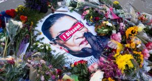 Flowers, candles and messages encircle an image of the late US justice Ruth Bader Ginsburg. It is understood her dying wish was that her successor  be appointed after the election. Photograph: Michael Reynolds