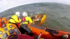 RNLI issue safety warning after fishermen rescued from capsized boat