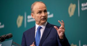 Taoiseach Micheál Martin defended reducing the pandemic payment on budgetary grounds. Photograph: Tom Honan/PA